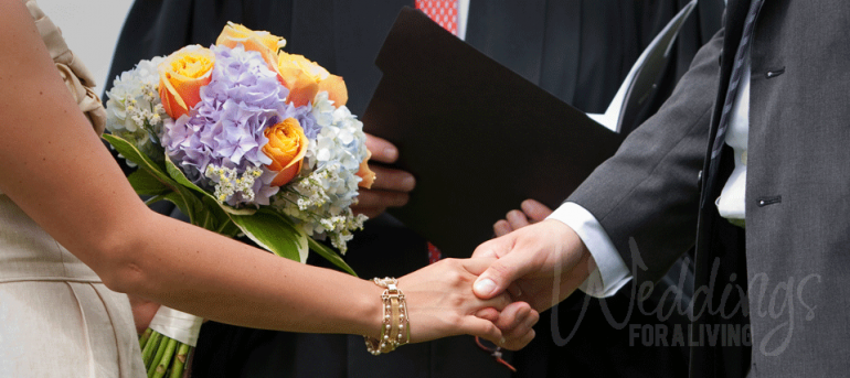 Couple at altar holding hands