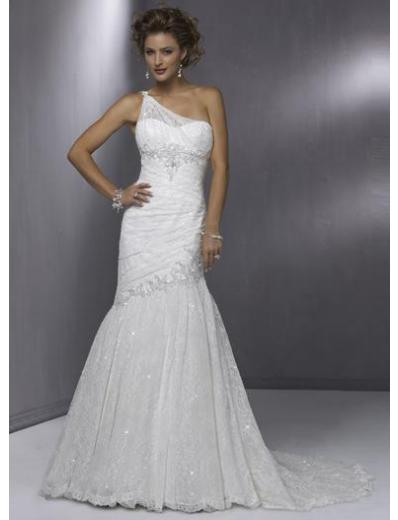 This bridal gown has an asymmetrical neckline and an asymmetrical dropped waistline